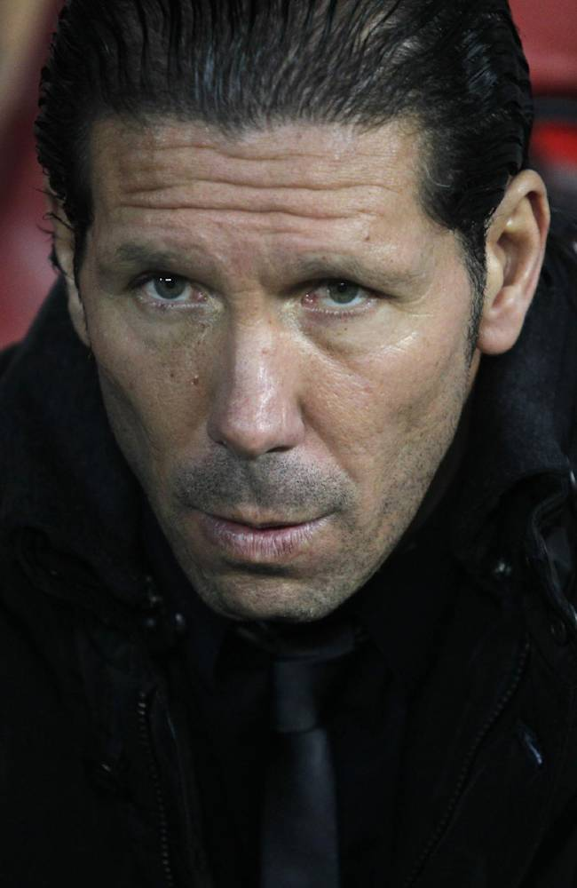 Atletico Madrid's coach Pablo Simone from Argentina waits for the start of the Champions League Group G soccer match between Atletico Madrid and Austria Vienna, at the Vicente Calderon stadium in Madrid, Wednesday, Nov. 6, 2013. Atletico Madrid won 4-0