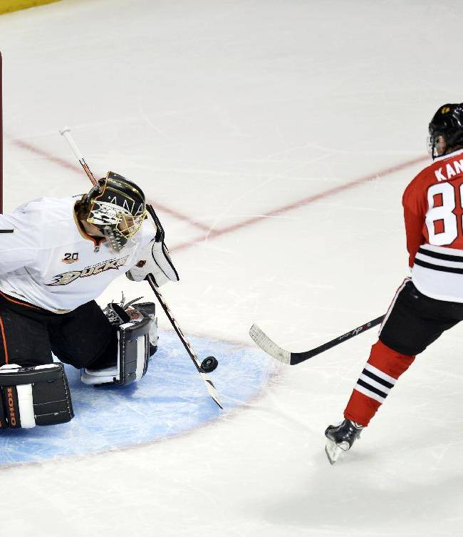 Anaheim Ducks goalie Jonas Hiller, left, stops a shot by Chicago Blackhawks right wing Patrick Kane during the shootout of an NHL hockey game Friday, Dec. 6, 2013, in Chicago. The Ducks won 3-2 in a shootout