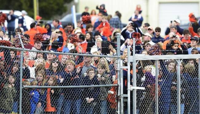 Hundreds of fans turn out as Auburn football team boards a flight at the Montgomery, Ala., airport as the Tigers leave for the BCS National Championship NCAA college football game on Tuesday, Dec. 31, 2013. Auburn plays Florida State in the national championship on Monday, Jan. 6, 2014, in Pasadena, Calif