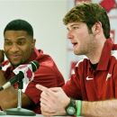 IFLE - This Jan. 21, 2012 file photo shows Arkansas quarterback Tyler Wilson, right, and running back Knile Davis, left, speaking to the media about foregoing the draft to return to college football, in Fayetteville, Ark. Arkansas has not one, but two Heisman Trophy hopefuls in Wilson and Davis. (AP Photo/April L. Brown, File)