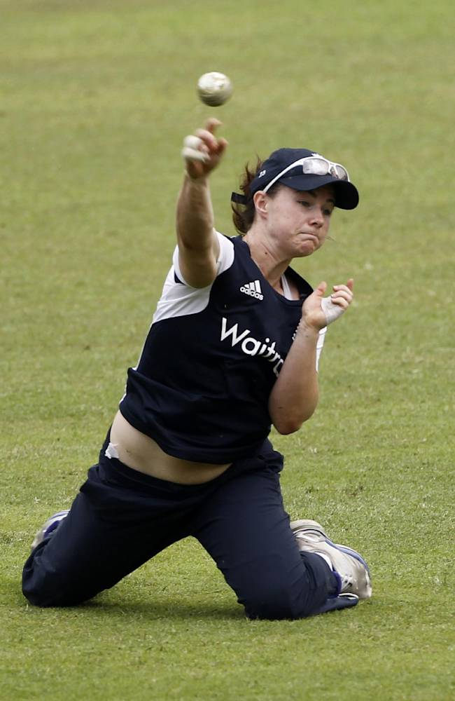 England women's team cricketer Tammy Beaumont throws the ball during a training session ahead of their ICC Twenty20 Cricket World Cup final match against Australia in Dhaka, Bangladesh, Saturday, April 5, 2014