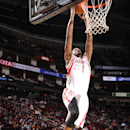 HOUSTON, TX - OCTOBER 13: Trevor Ariza #1 of the Houston Rockets dunks against the Phoenix Suns on October 13, 2014 at the Toyota Center in Houston, Texas. (Photo by Bill Baptist/NBAE via Getty Images)
