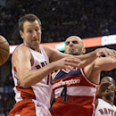 Toronto Raptors' Steve Novak, left, blocks Washington Wizards' Marcin Gortat during the second half of an NBA basketball game in Toronto on Friday, Nov. 22, 2013 The Associated Press
