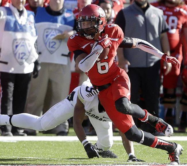 Utah wide receiver Dres Anderson (6) outruns Colorado defensive back Tedric Thompson (9) in the first half during an NCAA college football game Saturday, Nov. 30, 2013, in Salt Lake City. Utah won 24-17