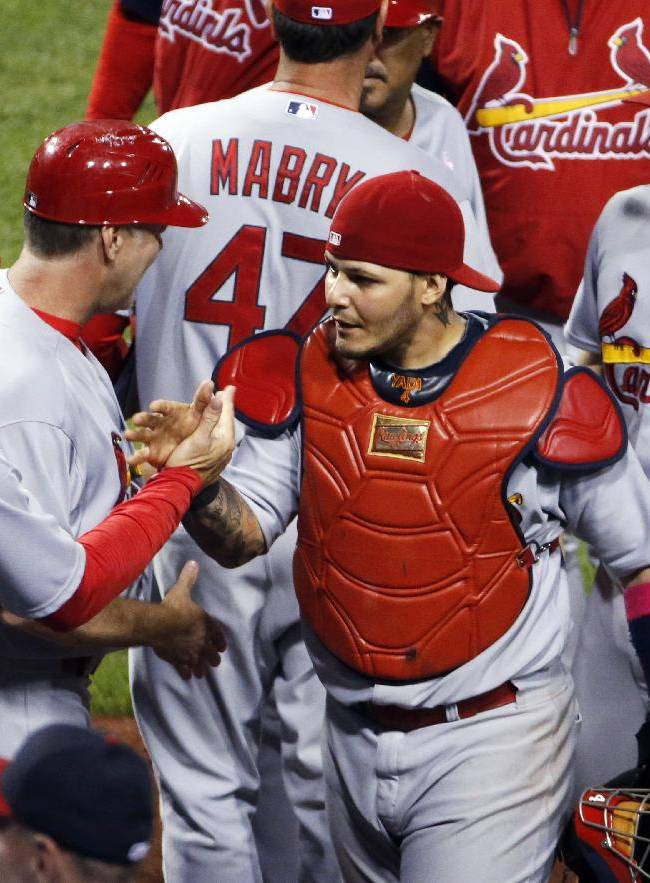 St. Louis Cardinals manager Mike Matheny, left, celebrates with catcher Yadier Molina, center, and relief pitcher Trevor Rosenthal (26) after a 6-5 win over the Pittsburgh Pirates in a baseball game in Pittsburgh, Sunday, May 11, 2014