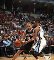 MEMPHIS, TN - NOVEMBER 22: Tony Parker #9 of the San Antonio Spurs dribbles the ball up against Mike Conley #11 of the Memphis Grizzlies on November 22, 2013 at FedExForum in Memphis, Tennessee. (Photo by Joe Murphy/NBAE via Getty Images)