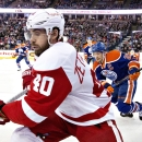 Detroit Red Wings Henrik Zetterberg (40) is chased by Edmonton Oilers Andrew Ference (21) during first period NHL hockey action in Edmonton, Alberta, on Tuesday Jan. 6, 2015 The Associated Press