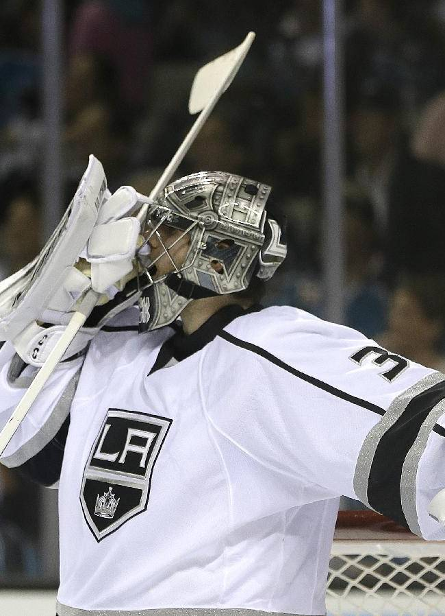 Los Angeles Kings goalie Jonathan Quick adjusts his mask during the second period of Game 1 of an NHL hockey first-round playoff series against the San Jose Sharks Thursday, April 17, 2014, in San Jose, Calif