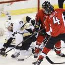 Pittsburgh Penguins' Douglas Murray, left, battles Ottawa Senators' Mark Stone (16) as Senators' Chris Phillips gets a shot away during second-period NHL hockey playoff game action in Ottawa, Ontario, Wednesday, May 22, 2013. (AP Photo/The Canadian Press, Adrian Wyld)