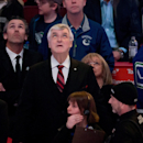 Former Vancouver Canucks' president and general manager Pat Quinn, centre, team president Trevor Linden, second left, and goalie Eddie Lack, right, of Sweden, watch a video tribute before Quinn's induction into the team's Ring of Honour before an NHL hock