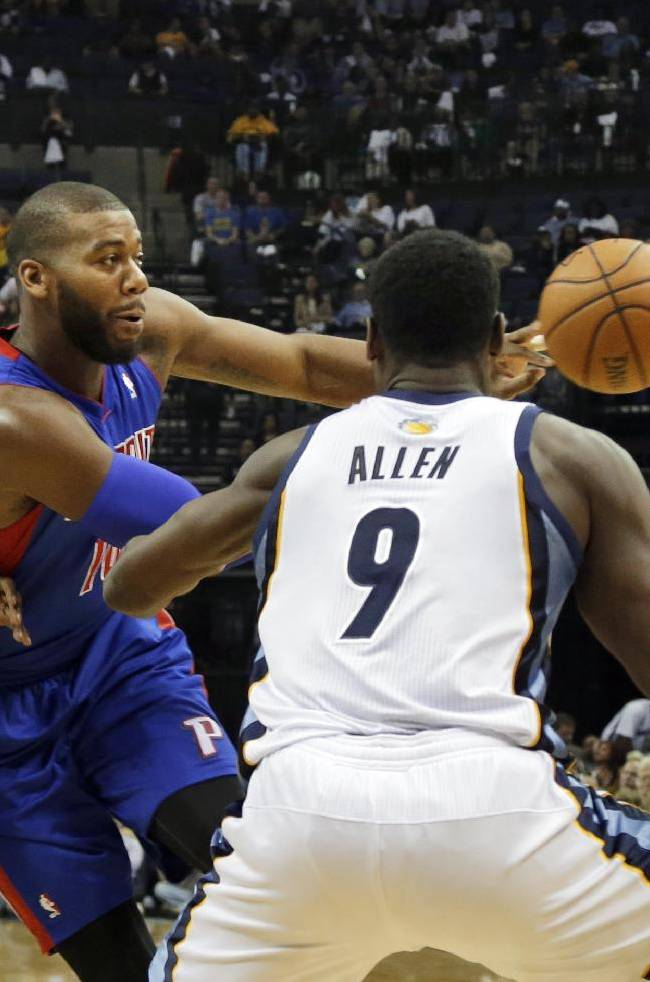 Detroit Pistons' Greg Monroe, center, passes the ball in front of Memphis Grizzlies' Tony Allen (9) as he is pressured by Zach Randolph (50) during the first half of an NBA basketball game in Memphis, Tenn., Friday, Nov. 1, 2013