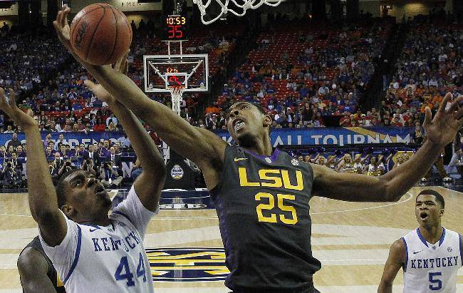 LSU forward Jordan Mickey (25) works against Kentucky center Dakari Johnson (44) during the first half of an NCAA college basketball game in the quarterfinal round of the Southeastern Conference men's tournament, Friday, March 14, 2014, in Atlanta