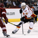 Calgary Flames' Mikael Backlund (11), of Sweden, tries to skate around Arizona Coyotes' Sam Gagner (9) during the second period of an NHL hockey game Thursday, Jan. 15, 2015, in Glendale, Ariz. The Flames won 4-1 The Associated Press