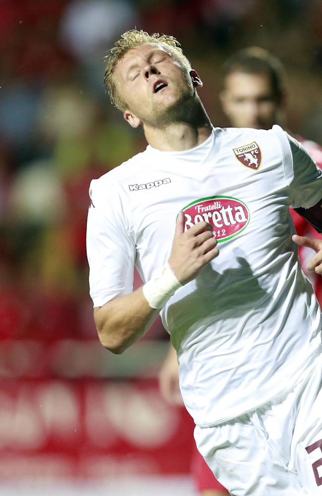 Torino's Kamil Glik reacts during the Europa League play-off soccer match between Torino and Split, in Dugopolje, Croatia, Thursday, Aug. 21, 2014