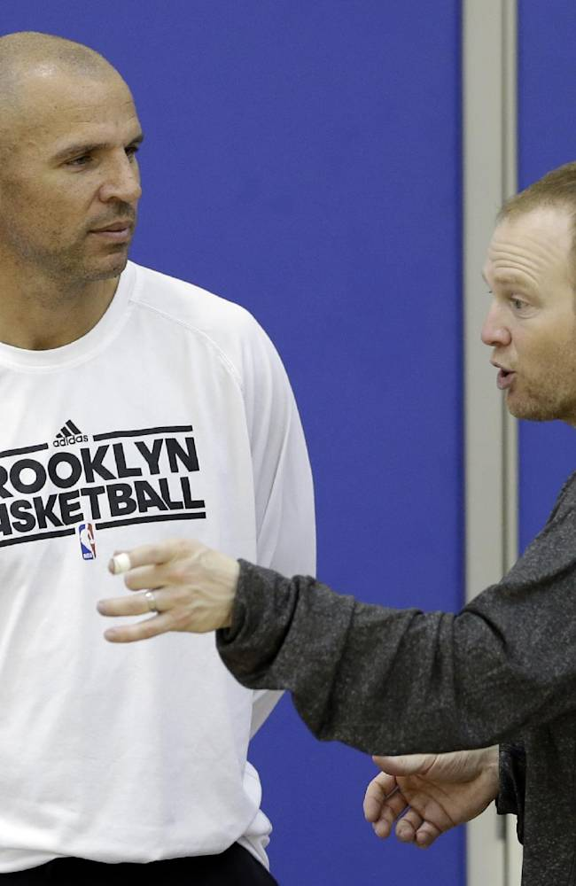 Brooklyn Nets coach Jason Kidd, left, and assistant coach Lawrence Frank talk during NBA basketball training camp at Duke University in Durham, N.C., Wednesday, Oct. 2, 2013
