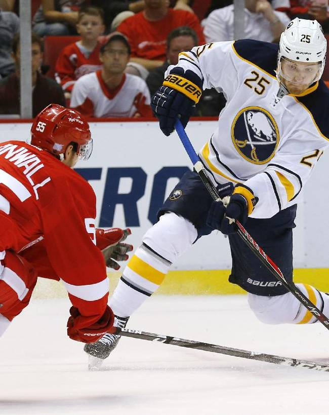Buffalo Sabres center Mikhail Grigorenko (25), of Russia, shoots as Detroit Red Wings defenseman Niklas Kronwall (55), of Sweden, defends during the first period of an NHL hockey game in Detroit, Wednesday, Oct. 2, 2013