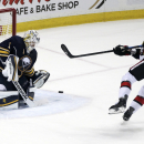 Buffalo Sabres goaltender Jhonas Enroth (1), of Sweden, makes a save on Ottawa Senators center Kyle Turris (7) during a shootout of an NHL hockey game Monday, Dec. 15, 2014, in Buffalo, N.Y. Buffalo won 5-4 The Associated Press