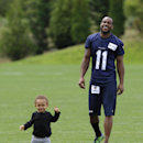 Seattle Seahawks wide receiver Percy Harvin, right, laughs as his son Jaden, 1, as he runs on the field following the final day of NFL football training camp, Wednesday, Aug. 13, 2014, in Renton, Wash The Associated Press