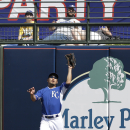 Kansas City Royals right fielder Norichika Aoki makes a catch on a ball hit by Los Angeles Dodgers' A.J. Ellis during the third inning of a spring exhibition baseball game Tuesday, March 11, 2014, in Suprise, Ariz The Associated Press