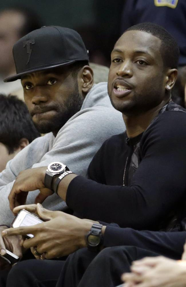 Wade returns, as reserve for Heat