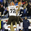 Cleveland Browns tackle Mitchell Schwartz (72) celebrates with quarterback Jason Campbell, right, after Campbell's touchdown pass to Jordan Cameron in the fourth quarter of an NFL football game against the New England Patriots, Sunday, Dec. 8, 2013, in Fo