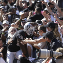 Oakland Raiders wide receiver James Jones (89) celebrates with fans after scoring on a 6-yard touchdown reception against the San Diego Chargers during the second quarter of an NFL football game in Oakland, Calif., Sunday, Oct. 12, 2014 The Associated Pre