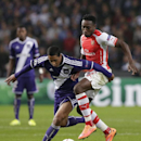 Anderlecht's Gohi Bi Zoro Cyriac, left, challenges Arsenal's Danny Welbeck for the ball during the Group D Champions League match between Anderlecht and Arsenal at Constant Vanden Stock Stadium in Brussels, Belgium, Wednesday Oct. 22, 2014