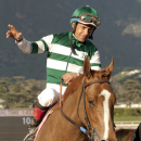In a photo provided by Benoit Photo, jockey Victor Espinoza waves aas Stellar Wind is guided into the winner's circle after their victory in the $100,000 Santa Ysabel Stakes horse race, Saturday, Feb. 28, 2015, at Santa Anita in Arcadia, Calif. (AP Photo/Benoit Photo)