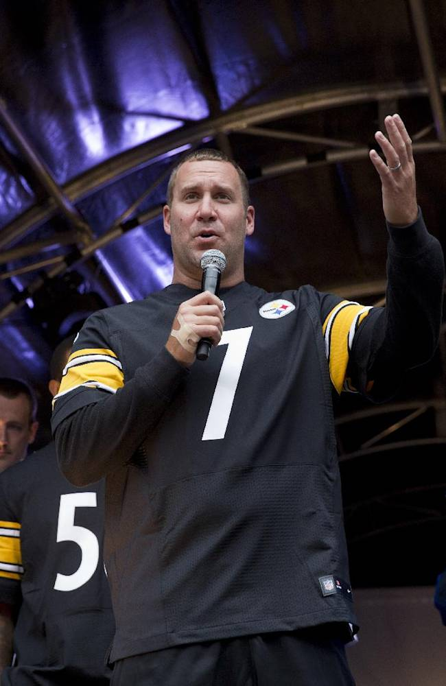 Pittsburgh Steelers quarterback Ben Roethlisberger, center, speaks on stage flanked by the team's chairman Dan Rooney, right, during an NFL fan rally event in Regent Street, London, Saturday, Sept. 28, 2013.  The Minnesota Vikings are to play the Pittsburgh Steelers at Wembley stadium in London on Sunday, Sept. 29 in a regular season NFL game