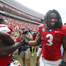 FILE - In this Sept. 27, 2014, file photo, Georgia running back Todd Gurley (3) celebrates with linebacker Amarlo Herrera (52) after an NCAA college football game against Tennessee in Athens, Ga. No. 9 Georgia continues to await word from the NCAA on the status of star tailback Todd Gurley for Saturday's game against Florida. Georgia has asked for the reinstatement of Gurley, who has acknowledged mistakes and has been suspended the last two games for an alleged violation of NCAA rules. (AP Photo/John Bazemore, File)