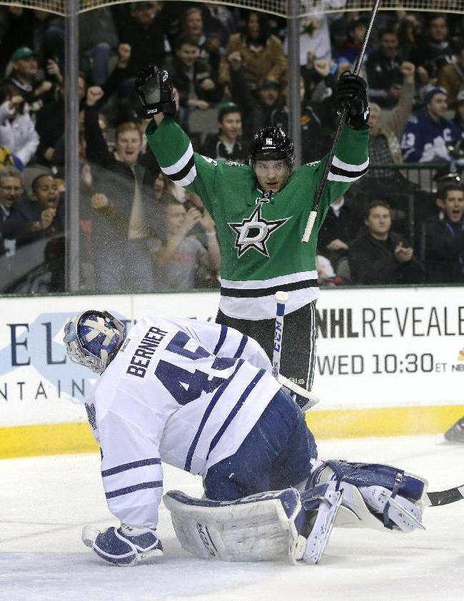 Dallas Stars' Ryan Garbutt (16) celebrates a goal by Cody Eakin (20) as Toronto Maple Leafs' Jonathan Bernier (45), Jake Gardiner (51) and Morgan Rielly (44) reach during the first period of an NHL hockey game Thursday, Jan. 23, 2014, in Dallas