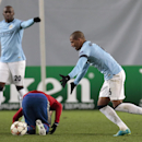 Manchester City's Fernando, right, reacts after fouling CSKA's Zoran Tosic during the Champions League Group E soccer match between CSKA Moscow and Manchester City at Arena Khimki stadium in Moscow, Russia, Tuesday Oct. 21, 2014
