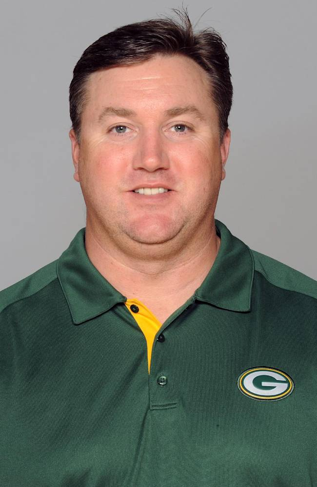 FILe - This is a 2012 file photo showing Green Bay Packers coach Alex Van Pelt.  Van Pelt may have one the toughest and easiest assistant coaching jobs in the NFL. He might be the new quarterbacks coach of the Packers, but in one sense there's only so much wisdom Van Pelt can impart when his top pupil is Aaron Rodgers