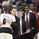 Louisville's Terry Rozier (0) hugs coach Rick Pitino during the second half of a regional semifinal against North Carolina State in the NCAA men's college basketball tournament Friday, March 27, 2015, in Syracuse, N.Y. Louisville won 75-65. (AP Photo/Nick Lisi)
