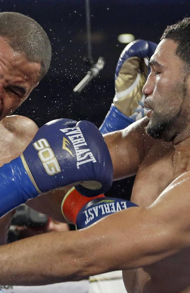 Andre Ward, left, and Edwin Rodriguez, of the Dominican Republic, trade punches in the fourth round of their super middleweight championship boxing match in Ontario, Calif., Saturday, Nov. 16, 2013. Ward won by unanimous decision