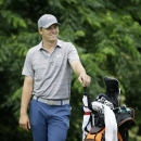 Jordan Spieth smiles while waiting for his tee shot on the 12th hole during the third round of the Colonial golf tournament, Saturday, May 23, 2015, in Fort Worth, Texas. (AP Photo/LM Otero)