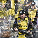 FILE - In this Aug. 9, 2014, file photo, Marcos Ambrose celebrates in Victory Lane after winning the NASCAR Nationwide Series auto race at Watkins Glen International in Watkins Glen N.Y. Richard Petty Motorsports lost driver Marcos Ambrose and primary sponsor Stanley in the span of five days, but the organization insisted Wednesday it is committed to running two cars in 2015. (AP Photo/Derik Hamilton, File)