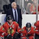 Chicago Blackhawks coach Joel Quenneville, top, yells to his team during the third period of the Blackhawks' preseason NHL hockey game against the Montreal Canadiens in Chicago, Wednesday, Oct. 1, 2014. The Canadiens won 3-1. (AP Photo/Nam Y. Huh)