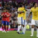 Brazil's Romulo, centre right, celebrates with teammate Sandro after scoring against South Korea during their semifinal men's soccer match at the 2012 London Summer Olympics, Tuesday, Aug. 7, 2012, at Old Trafford Stadium in Manchester, England. (AP Photo/Jon Super)