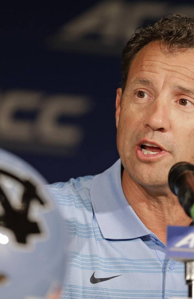 North Carolina head coach Larry Fedora answers a question during a news conference at the Atlantic Coast Conference football kickoff in Greensboro, N.C., Monday, July 21, 2014