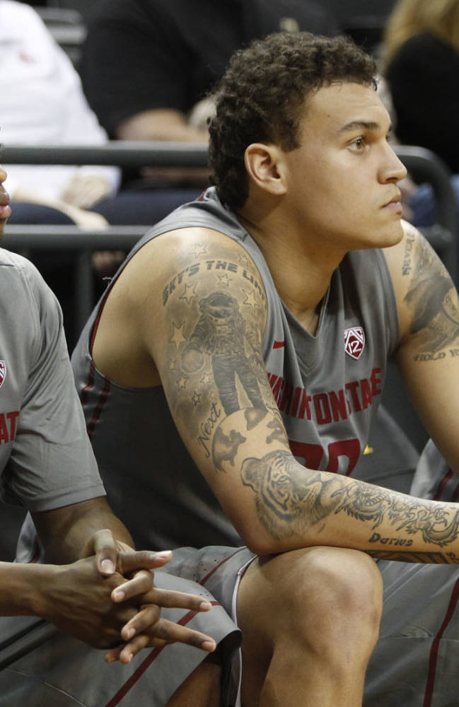 Washington State's Will Dilorio, left, Que Johnson, Jordan Railey and Ike Iroegbu watch as Oregon moves ahead during the second half of an NCAA college basketball game in Eugene, Ore., Sunday, Feb. 23, 2014