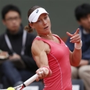 Australia's Samantha Stosur  returns the ball to Japan's Kimiko Date-Krumm during their first round match of the French Open tennis tournament at the Roland Garros stadium Tuesday, May 28, 2013 in Paris. (AP Photo/Petr David Josek)