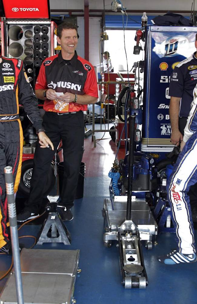 Driver Matt Kenseth, third from left, laughs with driver Brad Keselowski, right, during practice for Sunday's NASCAR Sprint Cup Series auto race at Talladega Superspeedway in Talladega, Ala., Friday, Oct. 18, 2013
