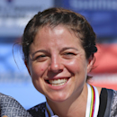 Evelyn Stevens of the U.S. shows her gold medal after winning the women's team trial event over 36.15 kilometers (22.46 miles) for the third consecutive year with her Specialized-Lululemon team at the Road Cycling World Championships in Ponferrada, north-western Spain, Sunday, Sept. 21, 2014. (AP Photo/Daniel Ochoa de Olza)