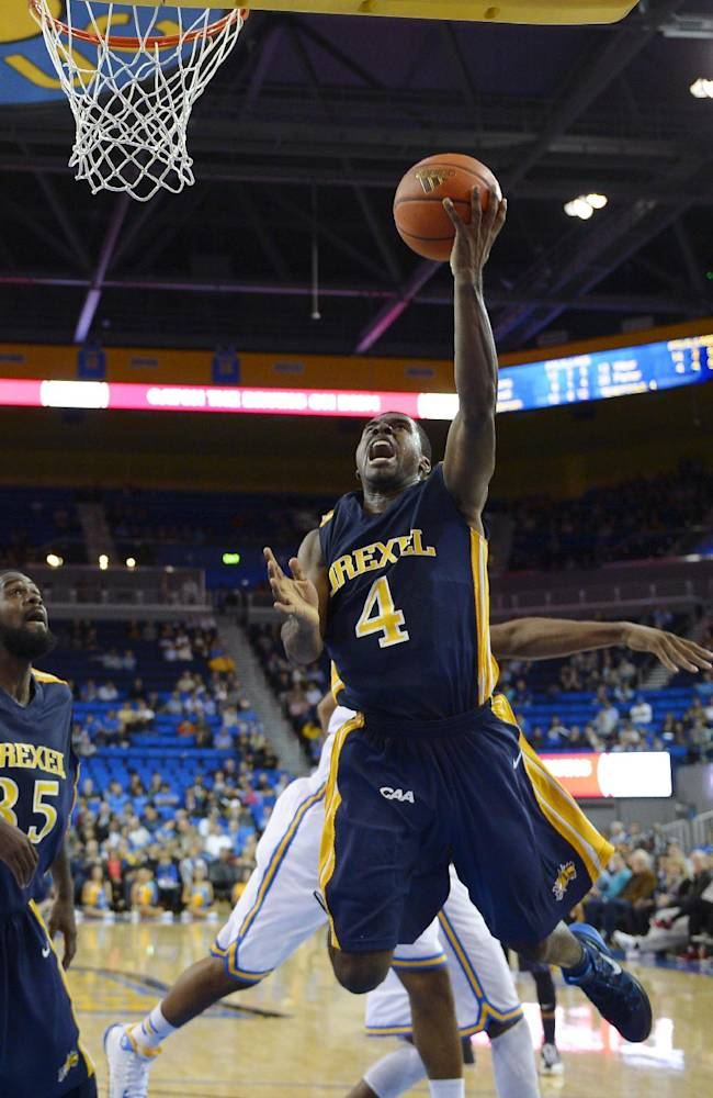 Drexel guard Frantz Massenat, right, puts up a shot as forward Dartaye Ruffin looks on during the second half of an NCAA college basketball game against UCLA, Friday, Nov. 8, 2013, in Los Angeles. UCLA won 72-67