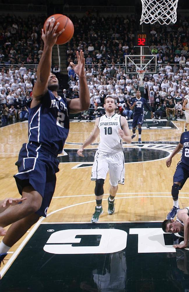 Penn State's D.J. Newbill (2) gets a fast-break layup against Michigan State's Travis Trice, left, Matt Costello (10) and Kenny Kaminski, right, and Penn State's Tim Frazier (23) during the second half of an NCAA college basketball game on Thursday, Feb. 6, 2014, in East Lansing, Mich. Michigan State won 82-67
