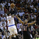 New York Knicks small forward Carmelo Anthony (7) prepares to shoot over Miami Heat small forward Shane Battier (31) during the first half of an NBA basketball game in Miami, Thursday, Feb. 27, 2014 The Associated Press