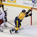 Nashville Predators center Colin Wilson (33) celebrates after scoring the go-ahead goal past Columbus Blue Jackets center Ryan Johansen (19) goalie Curtis McElhinney, behind, in the third period of an NHL hockey game Saturday, Nov. 29, 2014, in Nashville,