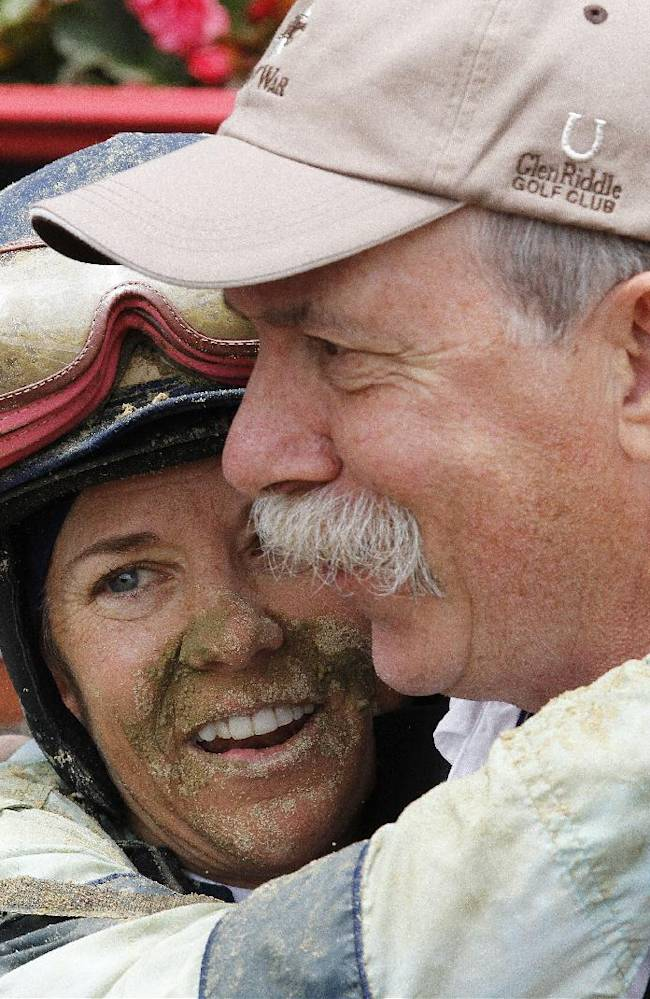 Jockey Andrea Seefeldt Knight, left, embraces horse owner Jim Macko after she won atop Zuerstgold during the Lady Legends for the Cure horse race at Pimlico Race Course, Friday, May 16, 2014, in Baltimore. The 139th Preakness horse race takes place Saturday