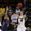 Washington's Talia Walton, left, defends Colorado's Rachel Hargis in the first half of an NCAA college basketball game in the Pac-12 Conference tournament Friday, March 8, 2013, in Seattle. (AP Photo/Elaine Thompson)